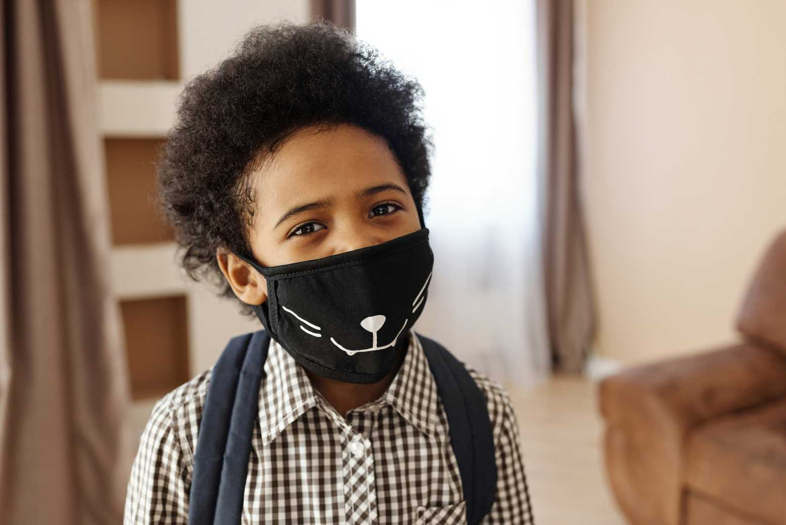 Canva - Little Boy Wearing a Face Mask With a Design.jpg