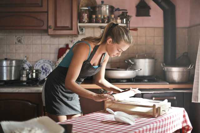 young-woman-rolling-dough-for-baking-in-kitchen-3771106.jpg